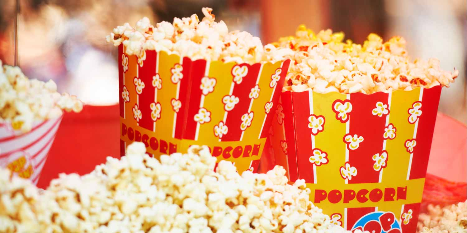 Closeup of movie theater popcorn that is on the list of foods to avoid with braces