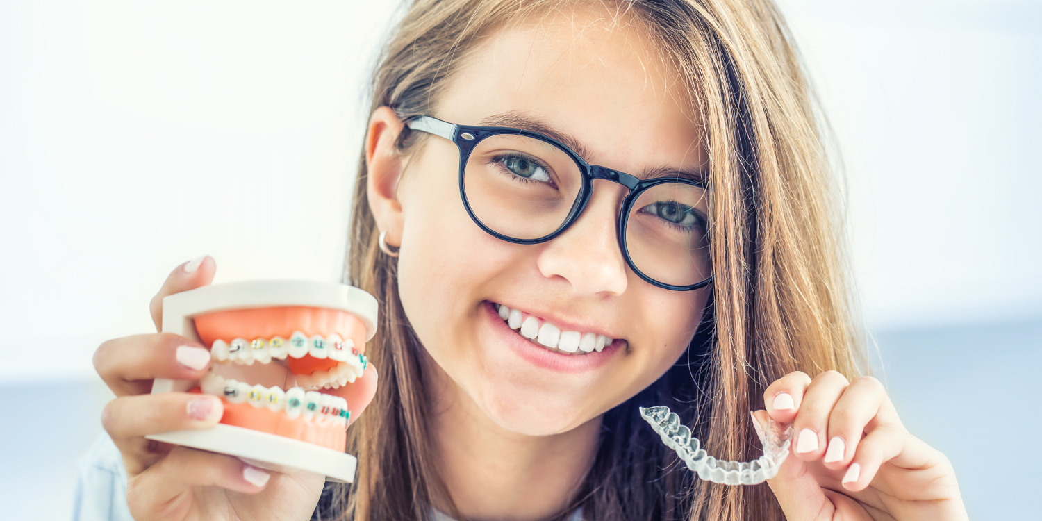 Brunette girl with glasses compares braces with clear aligners for her orthodontic treatment